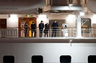 Japan says 23 passengers mistakenly left virus ship before testing
