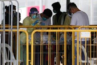 Singapore reports record jump in coronavirus cases