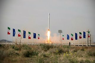 Iran says it launched military satellite as Trump threatens ships
