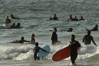 Australia permits home visits, opens beaches as coronavirus lockdown eases