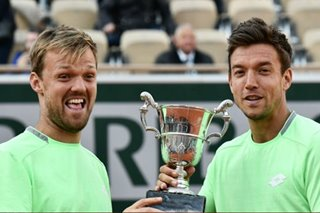 Tennis: French Open champ turns shelf stacker during pandemic