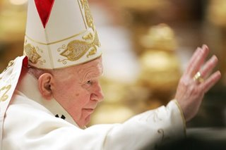 As Catholics mark 100 years since birth of John Paul, shadows remain