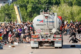 Truck driver arrested after Minneapolis protest scare