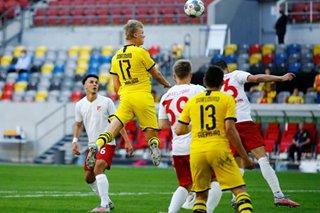 Football: Haaland's late winner for Dortmund keeps Bayern Munich waiting