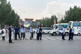 Beijing locks areas down as new virus outbreak gathers pace
