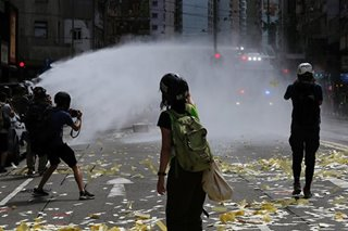 Hong Kong police fire water cannon at crowds protesting new security law