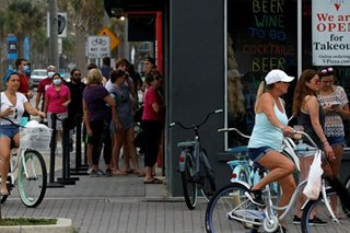 Miami rolls back restaurant dining as US COVID-19 deaths top 130,000
