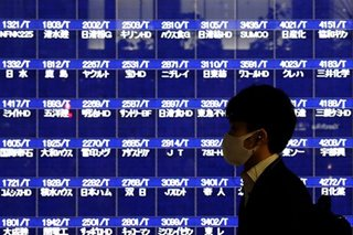Japan's financial watchdog to order Tokyo bourse to swiftly report on trading system glitch