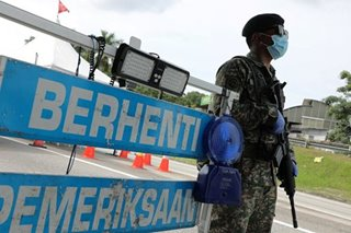 Malaysia tightens lockdown in some states as coronavirus cases surge
