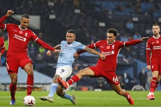 Football: City, Liverpool share spoils as Kane joins 150 club