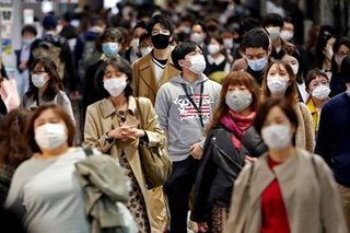Japan to loosen work rules on foreigners stuck due to pandemic