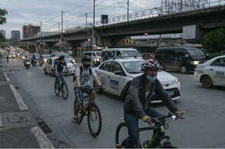 When the trains stopped, cyclists dodged Manila's choking traffic