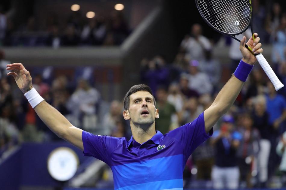 Serbia's Novak Djokovic celebrates after winning his 2021 US Open Tennis tournament men's semifinal match against Germany's Alexander Zverev at the USTA Billie Jean King National Tennis Center in New York, on September 10, 2021. Kena Betancur, AFP