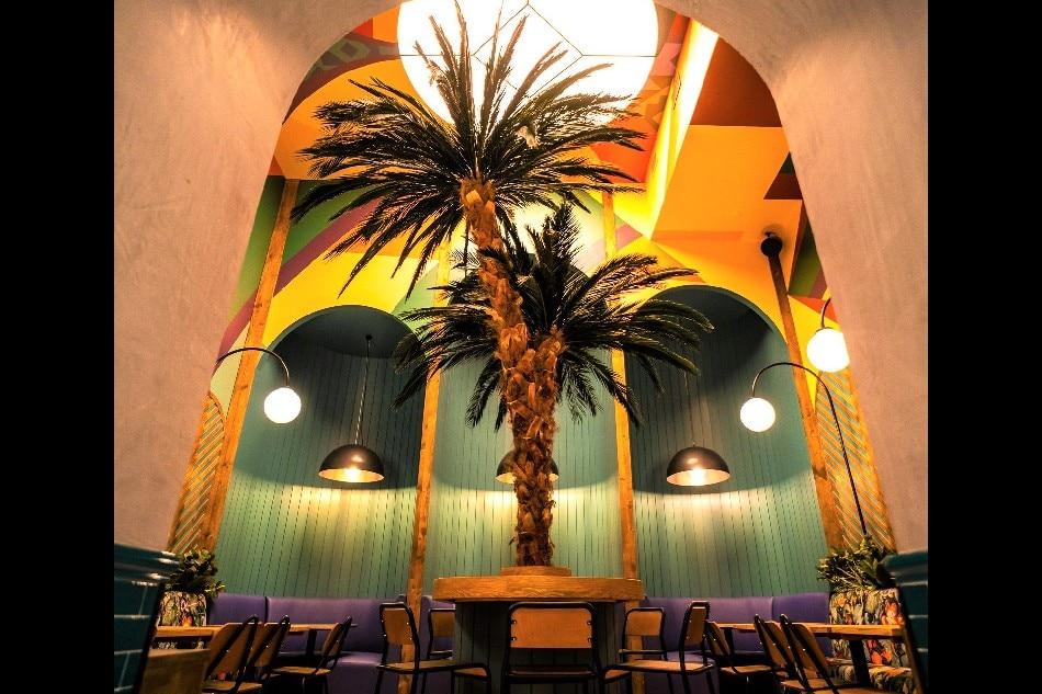 A palm tree inside Jollibee Madrid. Handout