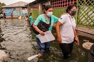 High tides, boat rides: Bringing lockdown aid to an island barangay