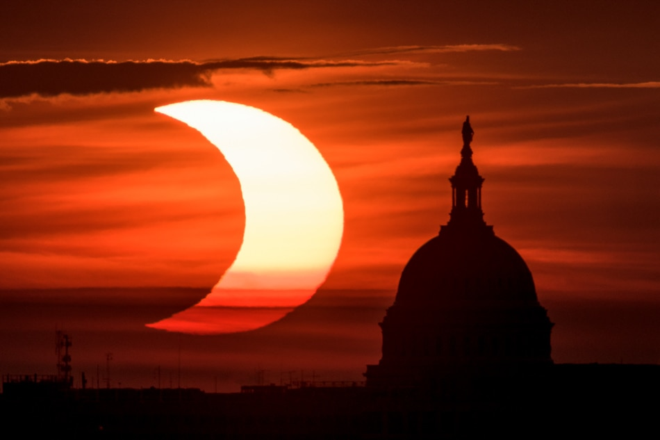 Crescent sunrise during partial solar eclipse in US