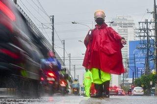 Directing traffic, rain or shine