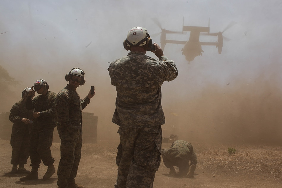 Soldiers take photos as a US Marine Aircraft Osprey takes off at Cagayancillo, Palawan, where US and Filipino troops are scheduled to conduct a community health and education training as part of the 2016 Balikatan Exercises, April 10, 2016. Dante Diosina Jr., ABS-CBN News/File