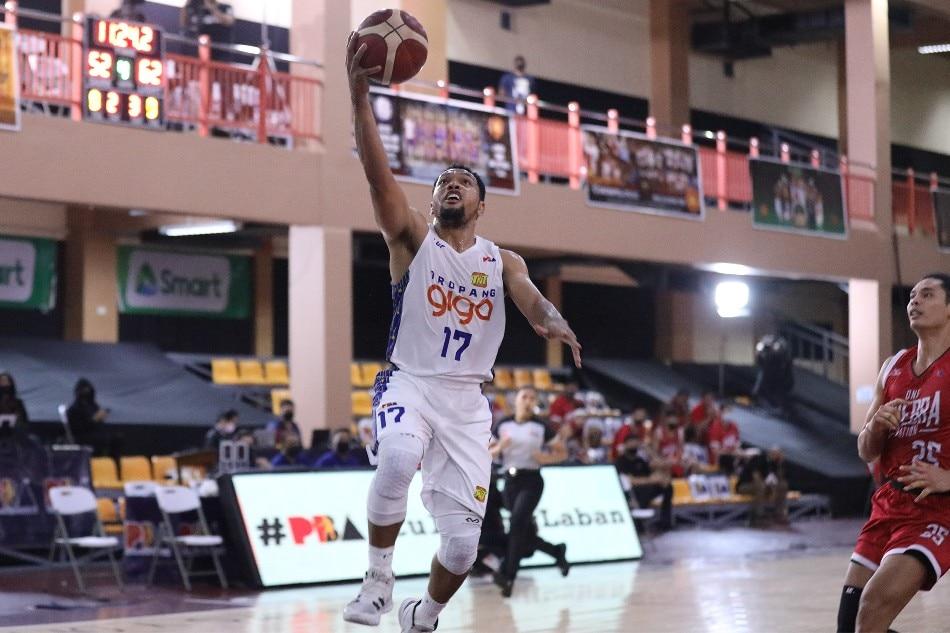 TNT guard Jayson Castro soars for a layup against Barangay Ginebra. PBA Media Bureau.