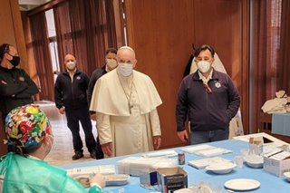 Pope makes surprise visit to homeless getting COVID-19 vaccine in Vatican