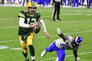 Rodgers, Packers on song as Rams downed in NFL playoffs