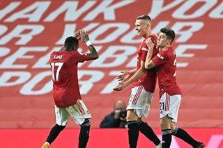 Football: Man Utd equal record with nine-goal blitz, Arsenal lose at Wolves