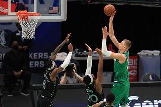 NBA: Mavericks build big lead, hang on to beat Wolves