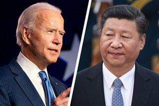 Biden presses Xi on HK, Xinjiang in first phone call