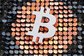 Dollar buoyed by US recovery hopes, bitcoin near record $52,640