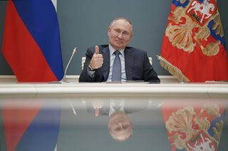 Putin signs law allowing him to serve 2 more terms