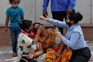 India's death toll hits new record as COVID-19 'tsunami' worsens