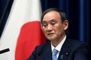 Japanese shares gain on Suga's resignation
