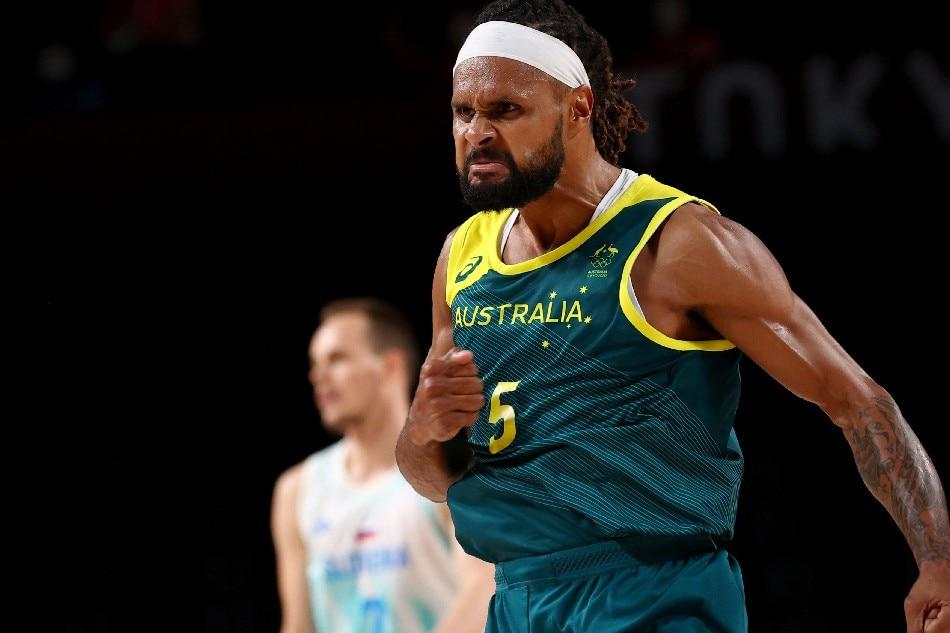 Patty Mills of Australia celebrates after scoring a basket. Brian Snyder, Reuters
