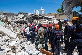 Death toll in massive Haiti quake jumps to over 1,200