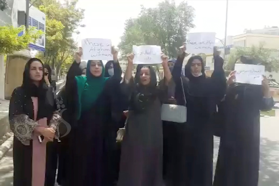 A group of women holds a street protest calling on the Taliban to protect their rights, in Kabul, Afghanistan August 17, 2021 in this still image taken from video dated August 17, 2021.
