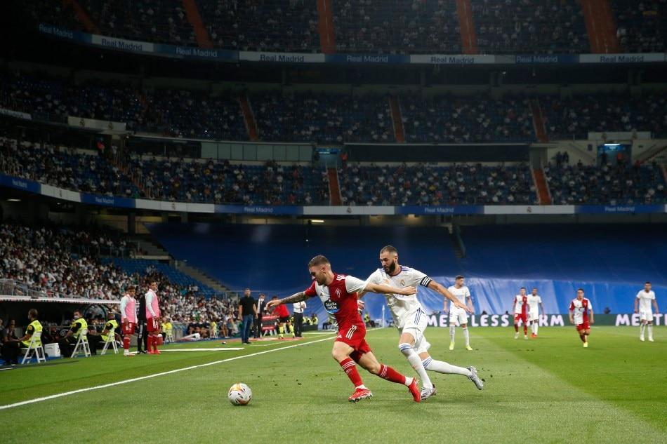 Celta Vigo's Javi Galan in action with Real Madrid's Karim Benzema. Susana Vera, Reuters.