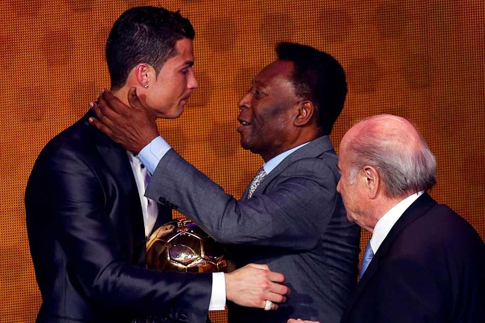 In this photo, Cristiano Ronaldo is congratulated by Pelé after being awarded the FIFA Ballon d'Or 2013 in January 2014. Arnd Wiegmann, Reuters/File
