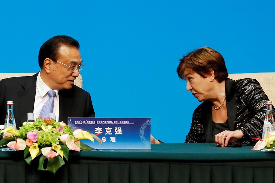 International Monetary Fund (IMF) Managing Director Kristalina Georgieva talks to Chinese Premier Li Keqiang before a news conference following the