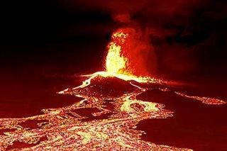 Canaries volcano lava gushes towards sea