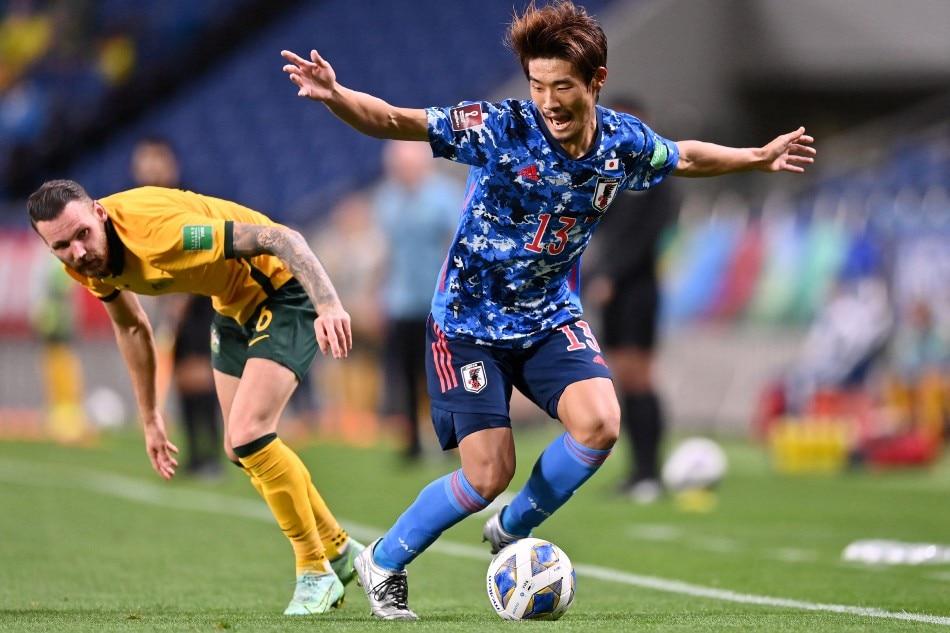 Japan's midfielder Hidemasa Morita (L) controls the ball as Australia's forward Martin Boyle looks on during the 2022 Qatar World Cup Asian Qualifiers group B football match between Japan and Australia, at Saitama Stadium in Saitama, on October 12, 2021. Charly Triballeau, AFP.