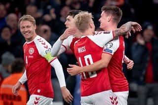 Football: Denmark book World Cup ticket as England held