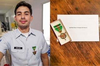 Triathlete Nikko Huelgas receives military merit medal