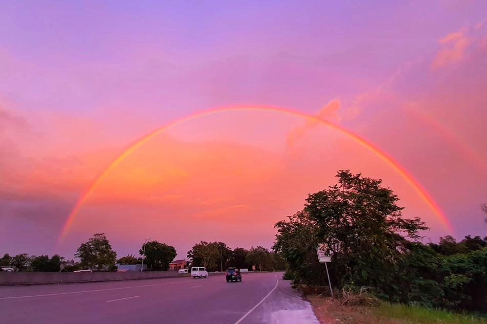 Rainbow under a pink sky