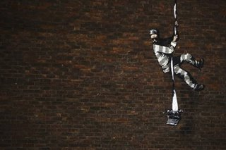 Banksy at work: Black hoodie, head torch, paint and freedom