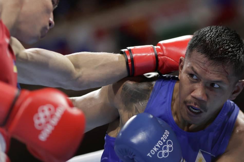 Eumir Marcial of the Philippines in action against Oleksandr Khyzhniak of Ukraine. Ueslei Marcelino, Reuters.