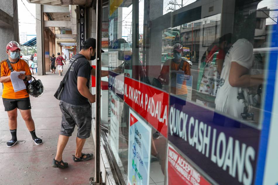 People visit a money changer and remittance business in Marikina City on January 21, 2021. Jonathan Cellona, ABS-CBN News/File