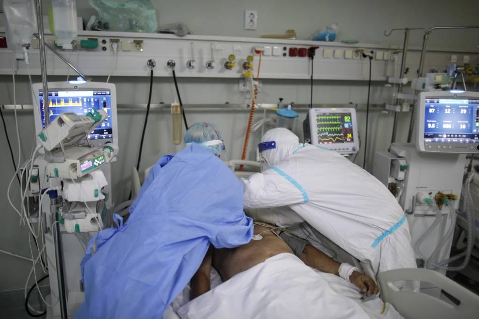 An intensive care unit (ICU) doctor and nurse, wearing Personal Protective Equipment (PPE) assist a coronavirus disease (COVID-19) patient at Marius Nasta Institute of Pneumology in Bucharest, Romania, on September 22, 2021. Inquam Photos/Octav Ganea via Reuters