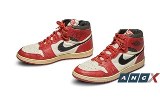 A pair of Nike Air Jordan 1s worn and signed by Michael Jordan just sold for USD560,000