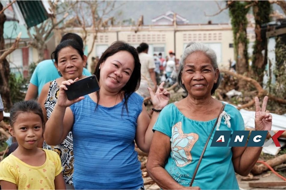 These Rolly survivors wanted their pictures taken so their relatives will know they're okay 2