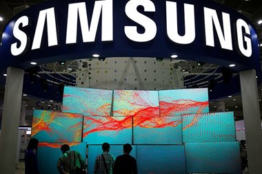Samsung mulls holding company move, boosts payout
